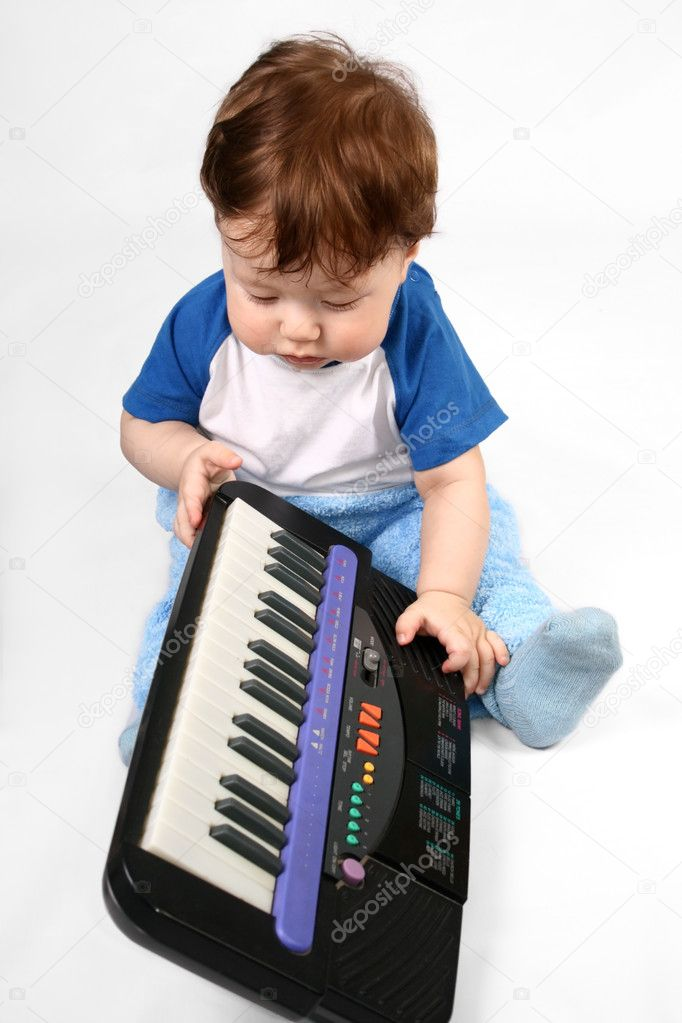 Little boy with electronic piano