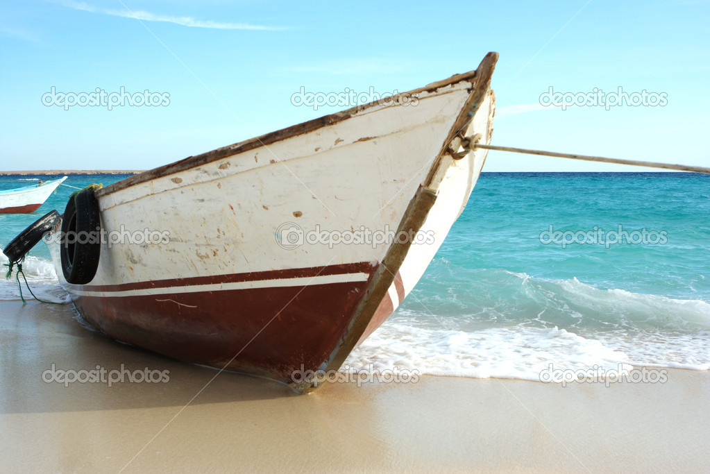 Fishing boat on Egypt beach waiting for