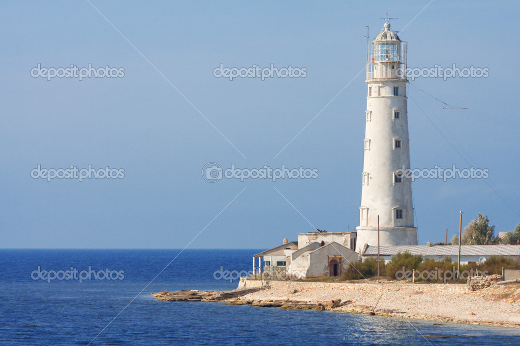 Lighthouse and sea