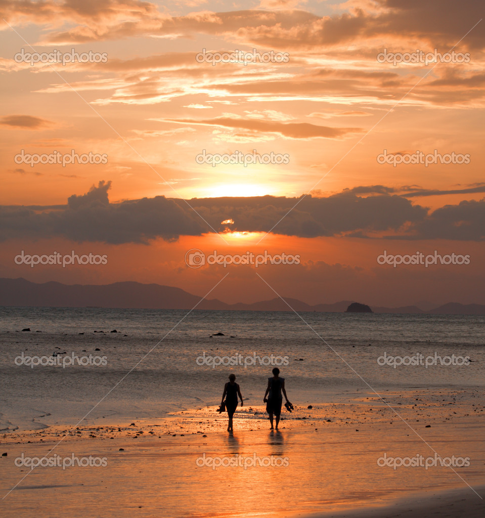 2 peoples on beach and sunset