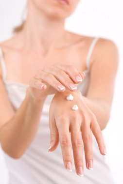 Woman puts a cream for beautiful hands
