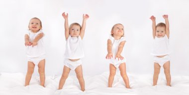 Beautiful baby dancing on bed stock vector