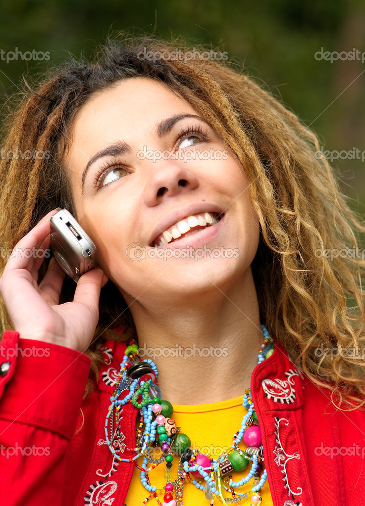 Girl with dreadlocks speaks by phone