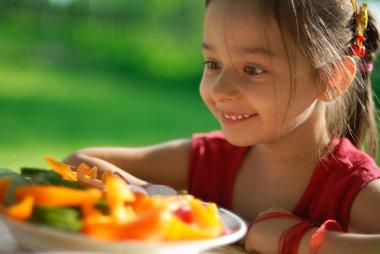 Girl joyfully is surprised to vegetabl