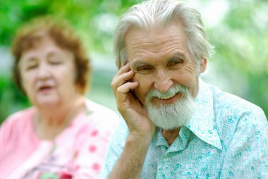Elderly woman tells a joke to husband