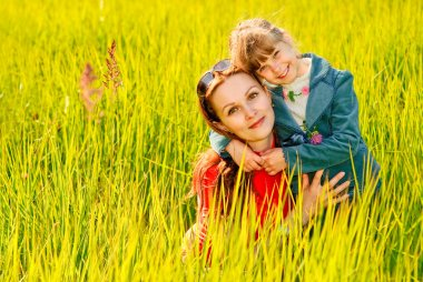Mother and daughter on a meadow
