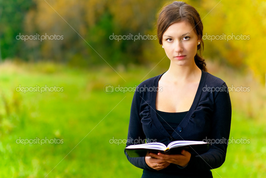 Girl with book in hands