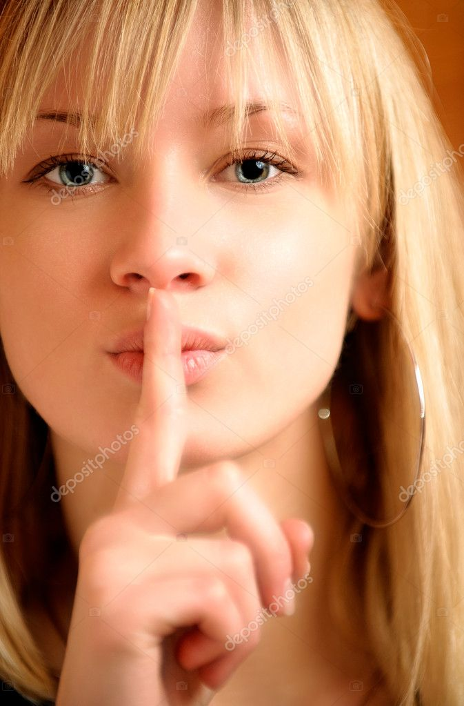 Blonde has put finger to lips