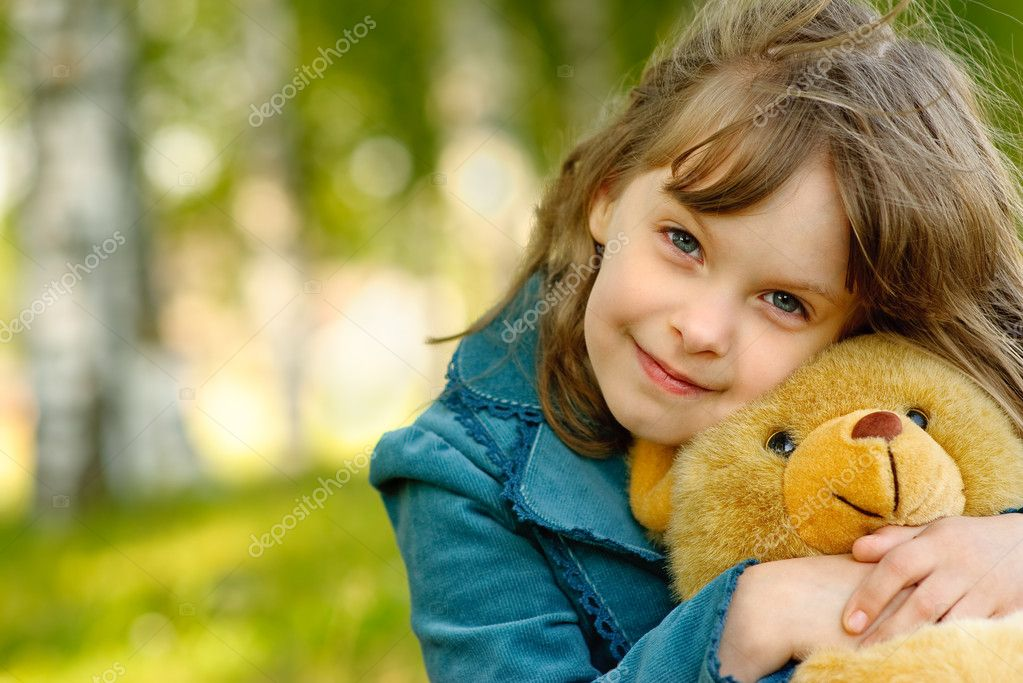 Child with toy bear cub