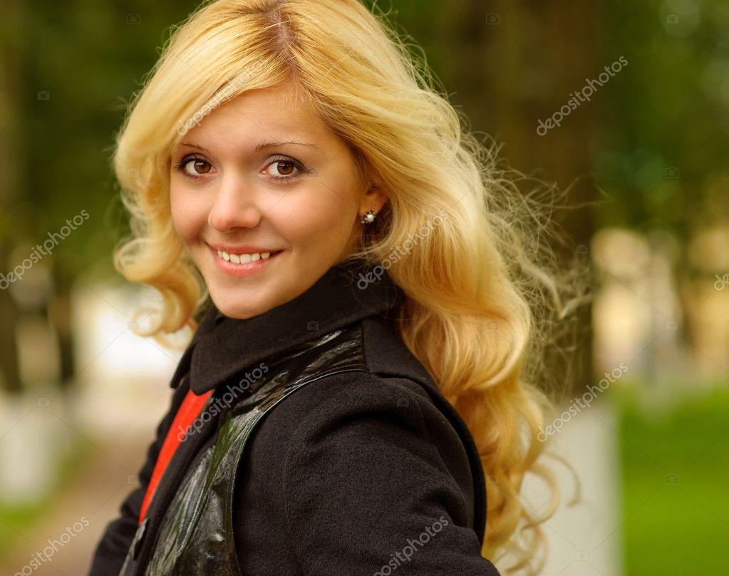 Portrait of girl in an even coat