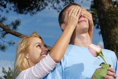 Girl behind closes eyes to young man