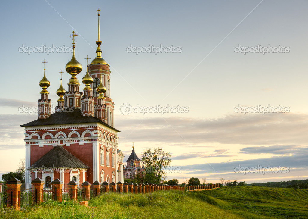 Ancient orthodox temple surrounded with beautiful flat nature.