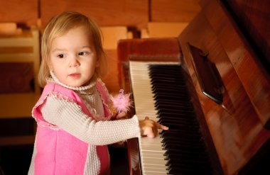 Young girl about piano