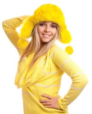Portrait of blonde in yellow fur cap