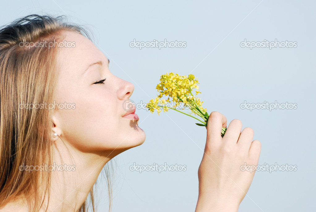The girl smells flowers