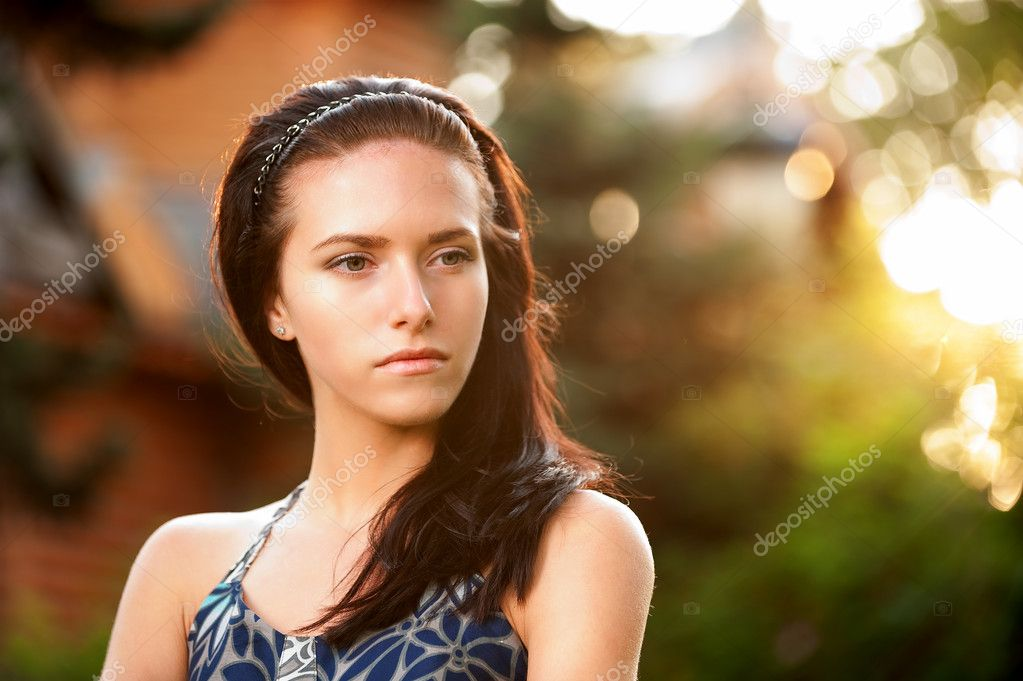 Portrait of beautiful dark-haired girl.