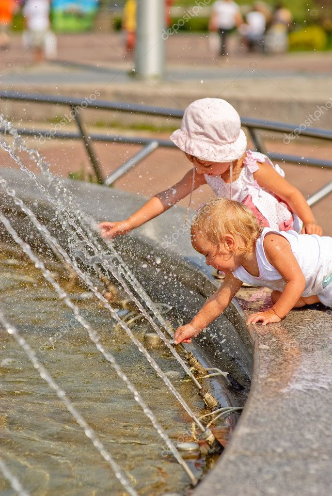 Sisters play at fountain