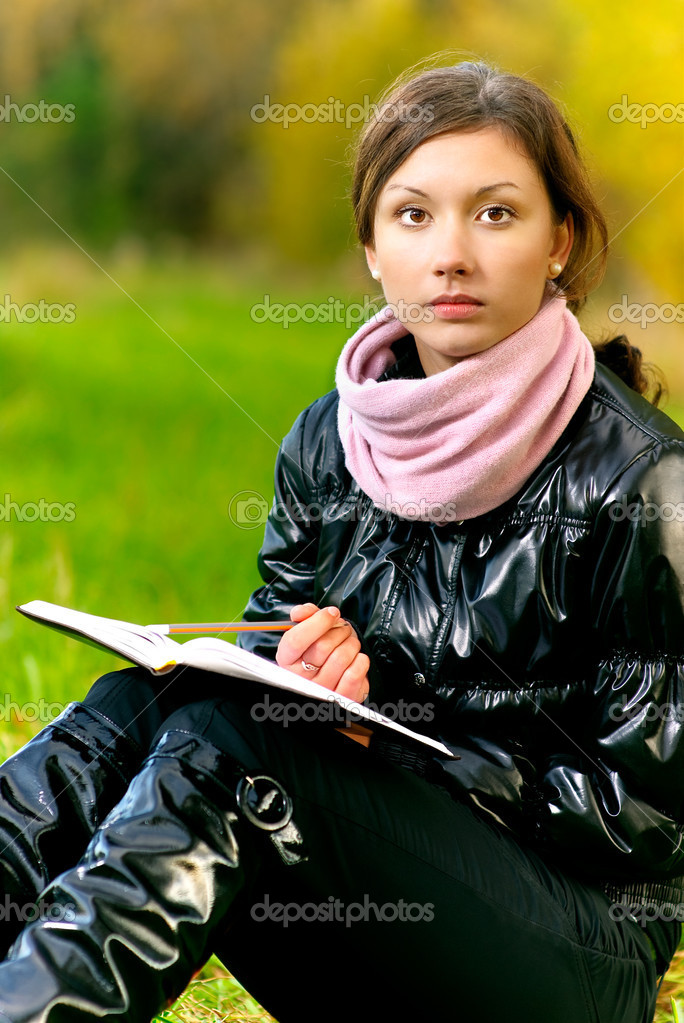 Beautiful girl reads book