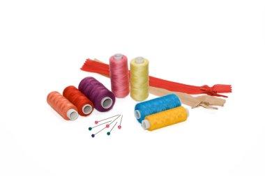 Different threads, zipper and pins