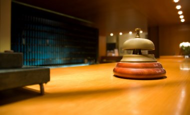 Brass bell on hotel reception