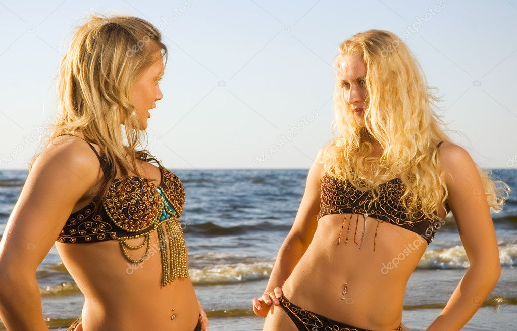 Two beautiful girls at the seaside
