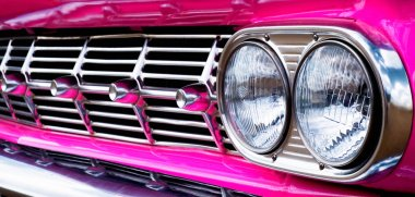 Close-up of car grill (pink Caddie)