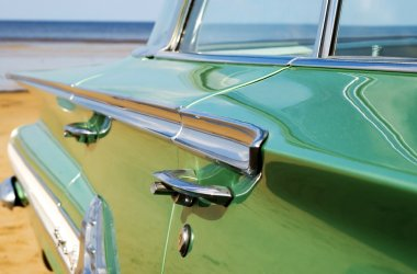 Classic green Cadillac at beach