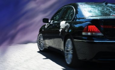 Wedding limo on the abstract background