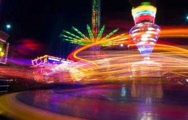 Amusement park at night stock vector