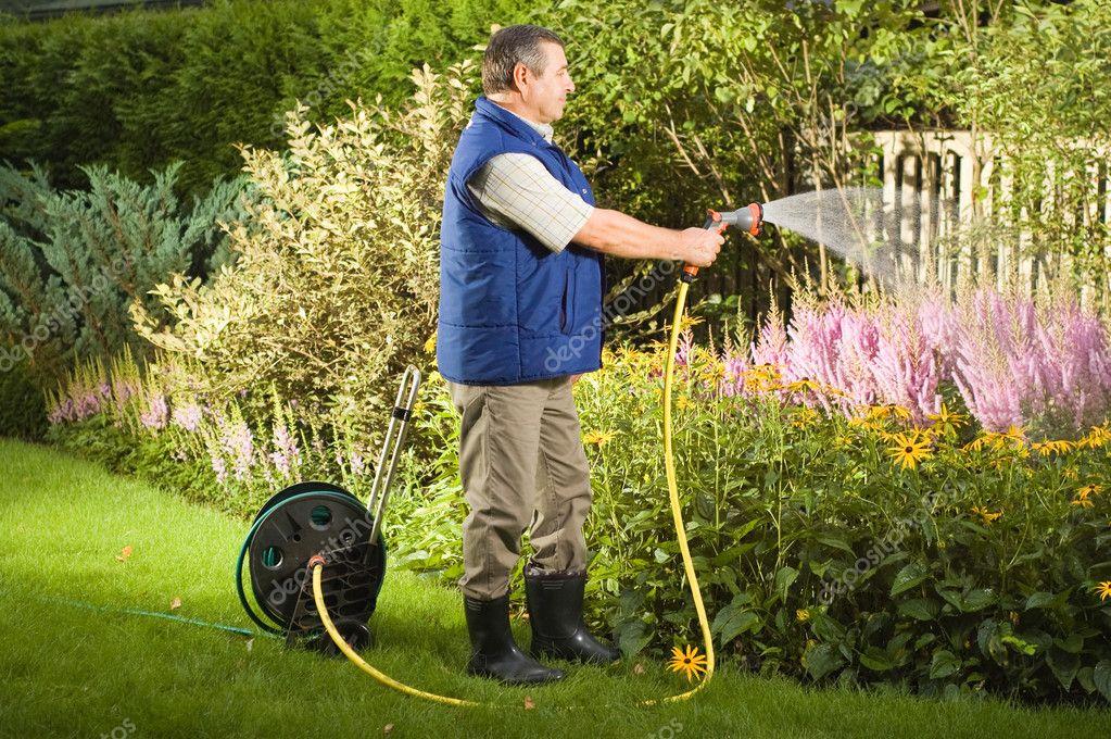 Man watering flowers in the garden