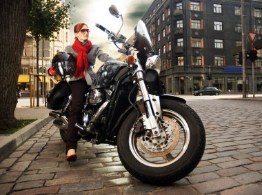 Beautiful woman on the motorcycle