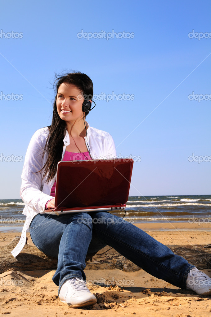 Woman on the beach with laptop
