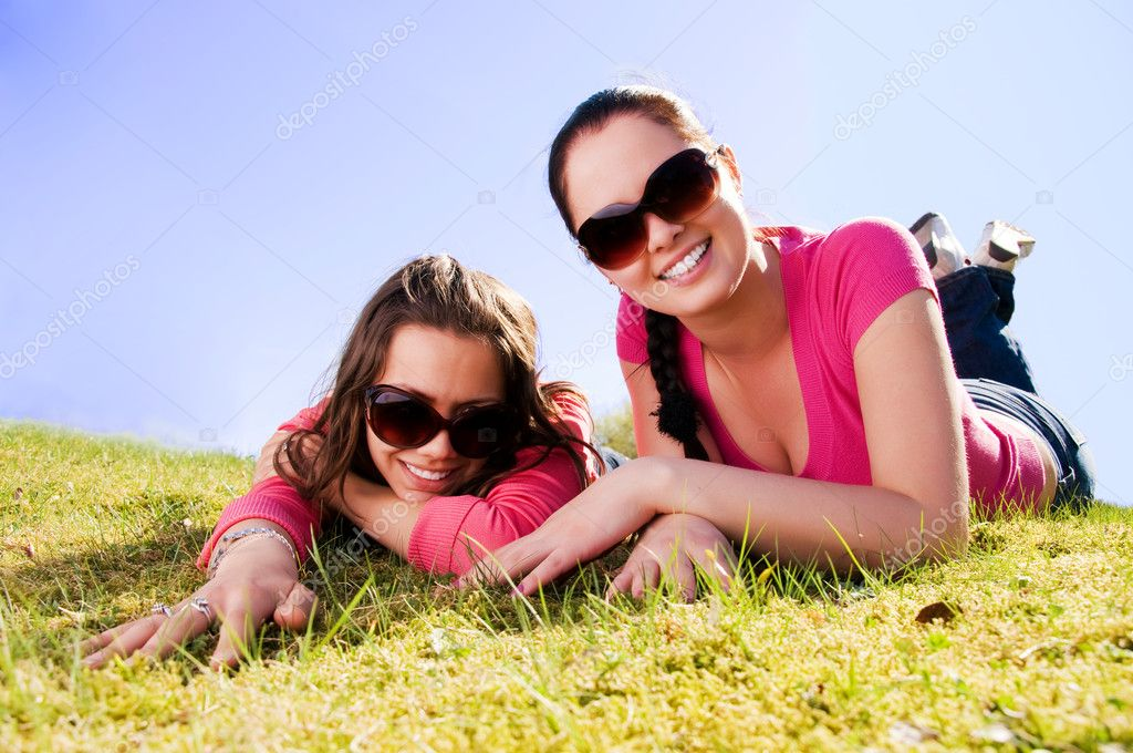 Two girls relaxing in a park