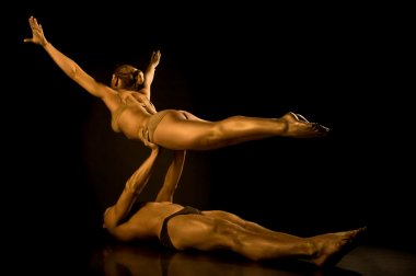Two acrobats toned in gold