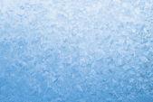 Fotografie hellblau gefrorenes Fensterglas