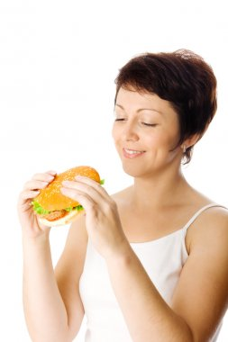 Smiling young woman with hamburger