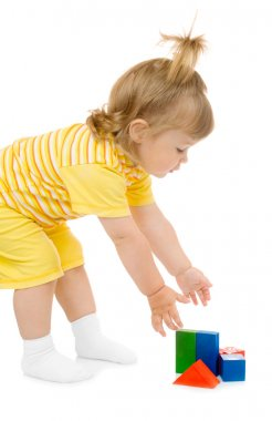 Little girl with toy cubes