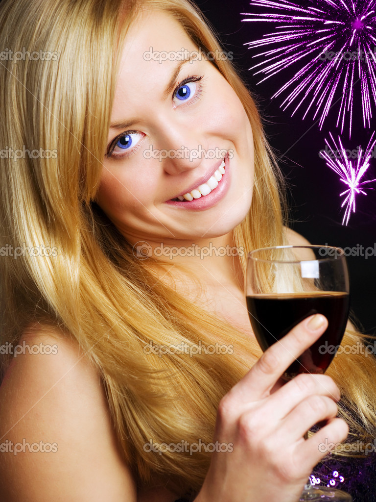 Smiling blond woman holding wine