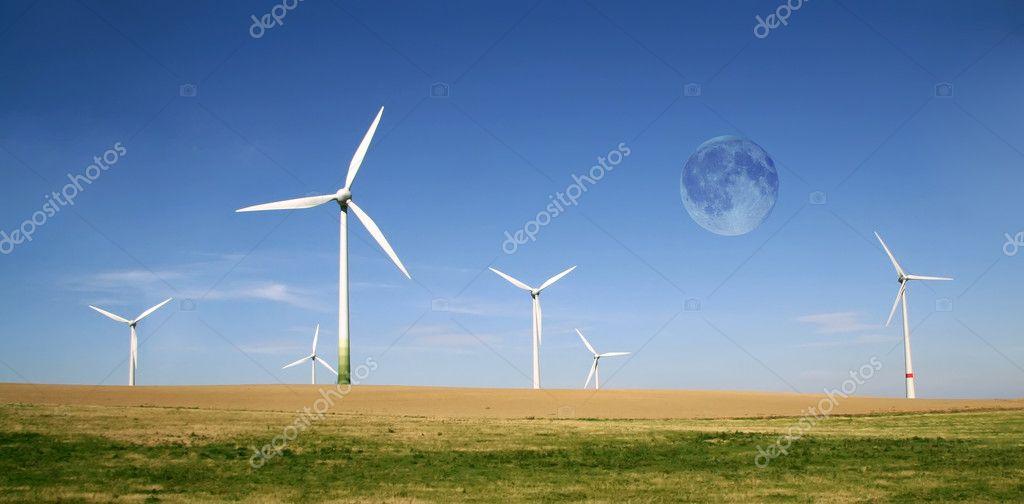 Wind turbines farm with full moon