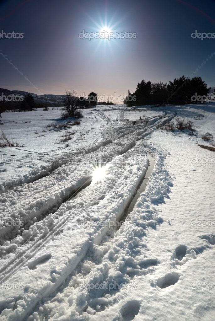 Winter snow road with sunshine star.