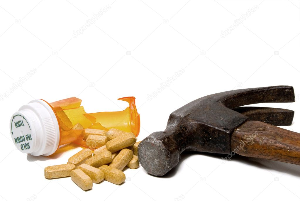 A prescription drug pill bottle smashed open with a hammer.