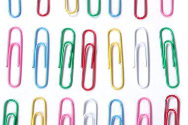 Colored paper clips stock vector