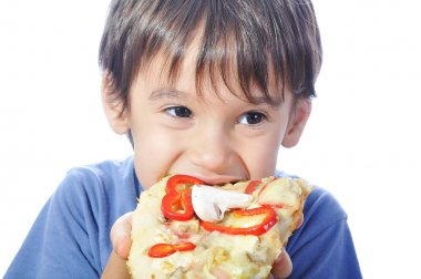 Cute little boy eating pizza, isolated