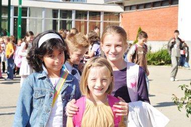 Happy children in front of the school, o