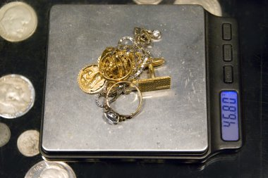 Gold jewelry and scale