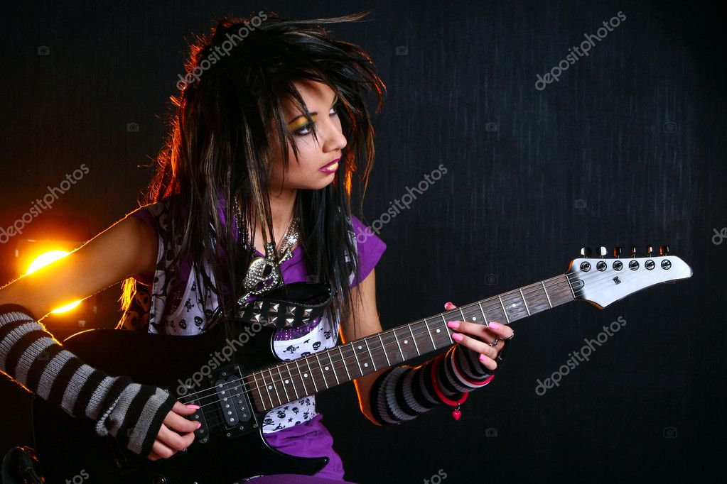 Emo girl with electric guitar