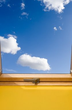 Window and bue sky with white clouds