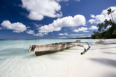 White sand beach with boat