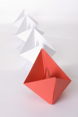 Winning red paper boat origami