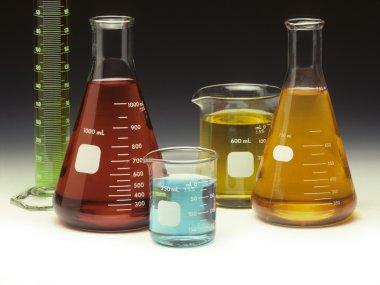 Scientific glassware filled with liquids